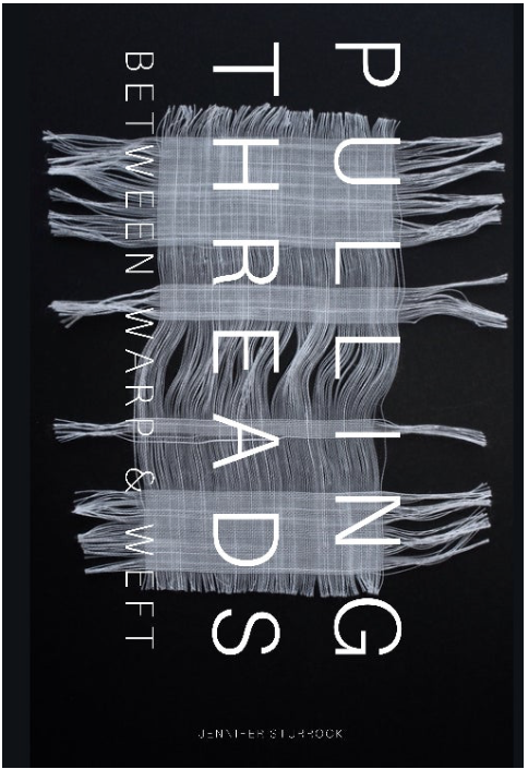 The jacket is black with an intricate set of fabric threads in white, across which the text runs vertically, so you would have to turn the whole jacket to your left to read it easily. The two words PULLING and THREADS are in large caps and run the whole width (each) of the jacket. Below them, smaller and paler is a subtitle (in one line) BETWEEN WARP & WEFT. The author's name is tiny and runs in normal horizontal mode at the very foot of the jacket. You can hardly see it. The threads run in four horizontal bands, with thin vertical threads between them. Hard to describe but quite attractive.