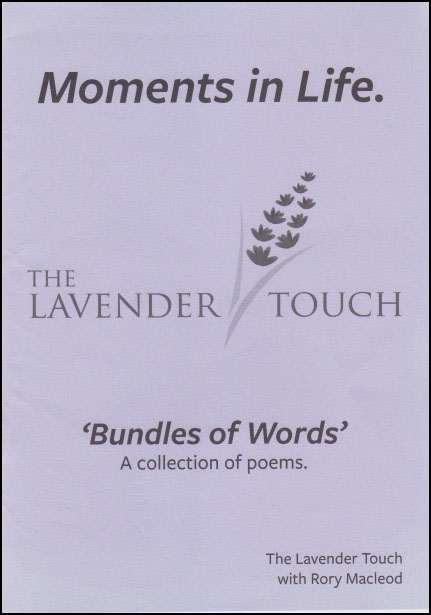 Mauve coloured jacket with black print mainly centred. Title at top large lower case reads Moments in Life. In the middle in caps THE LAVENDER TOUCH with drawing of a sprig of lavender. Below this, smaller, and inside single inverted commas, 'Bundles of Words', and below that even smaller A collection of poems. Author's name very small bottom right hand corner.
