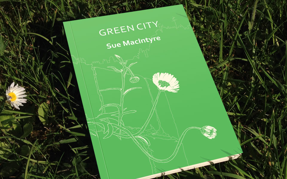 Photo of the pamphlet -- pale green jacket with white writing, and some leaves stalks and daisies also picked out in white, lying on some real grass with real daisies.