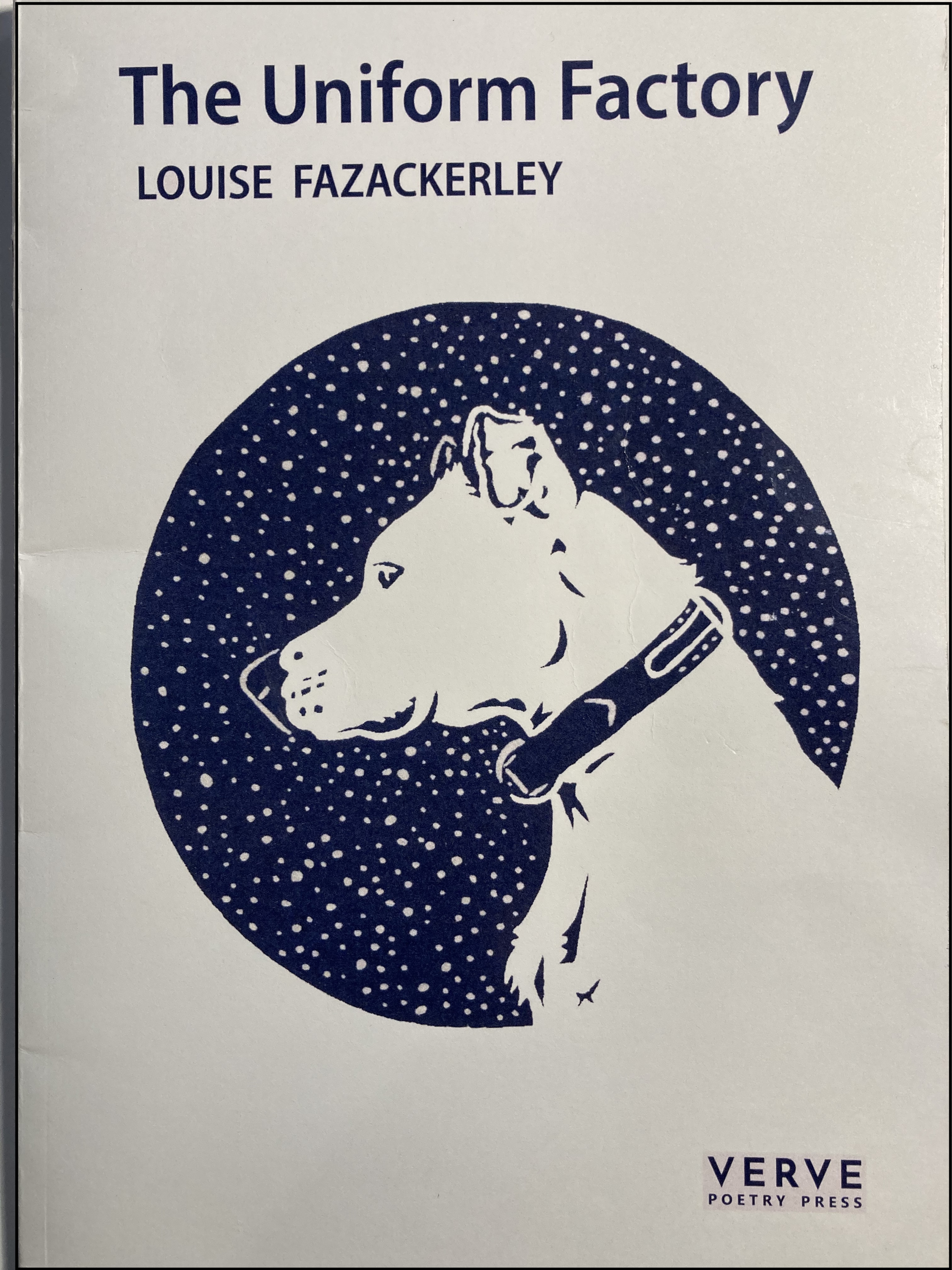Pale cover with blue lettering and central image: a blue circle with a white dog and spots like snow